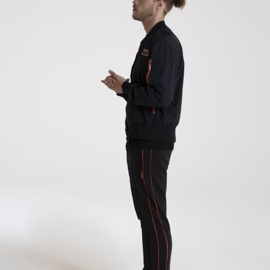 Zwarte bomber jas met oranje ritsen